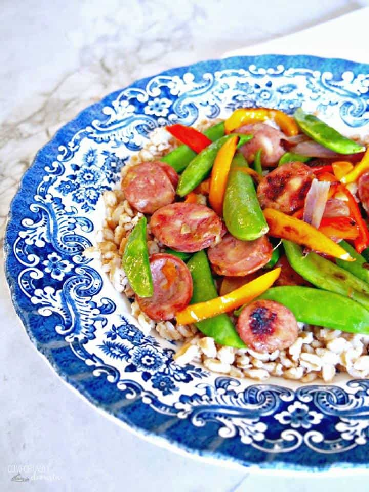 Sausage Stir Fry on a blue patterned platter from the side
