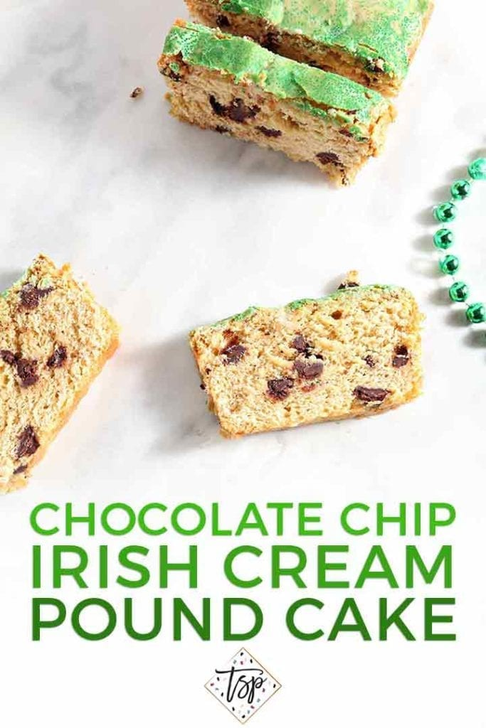 Several slices of a chocolate chip loaf cake sit on a marble surface next to a green set of beads with the text 'chocolate chip irish cream pound cake'