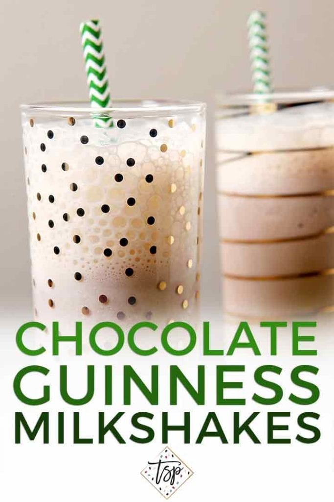 Close up of two glasses holding milkshakes with green straws and the text 'chocolate guinness milkshakes'