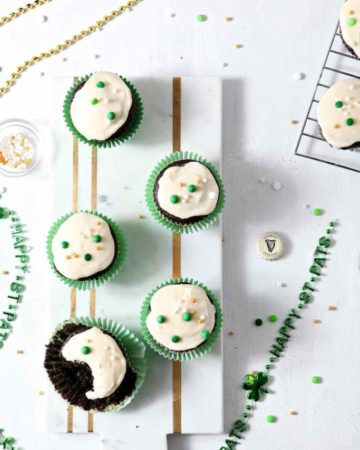 Chocolate Guinness Cupcakes with Creamy Bailey's Icing on a marble platter, displayed for a party
