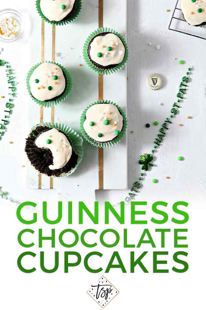 Overhead image of several decorated Chocolate Guinness Cupcakes with Pinterest text