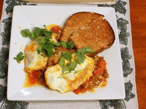 Moroccan Merguez Ragout with Poached Eggs from Pastry Chef Online on a white plate