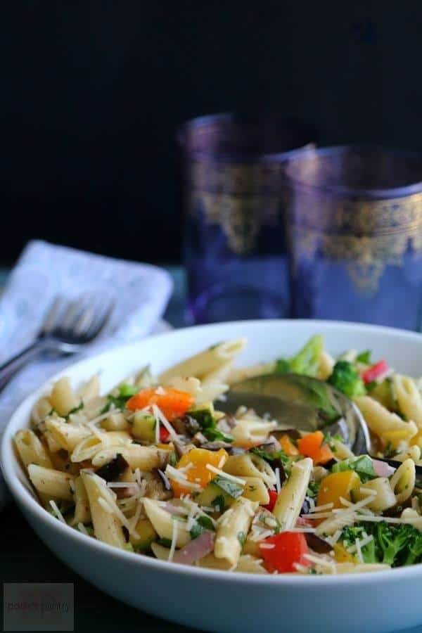 Colorful Oven Roasted Vegetable Herb Pasta, served in a white bowl on a dark backdrop