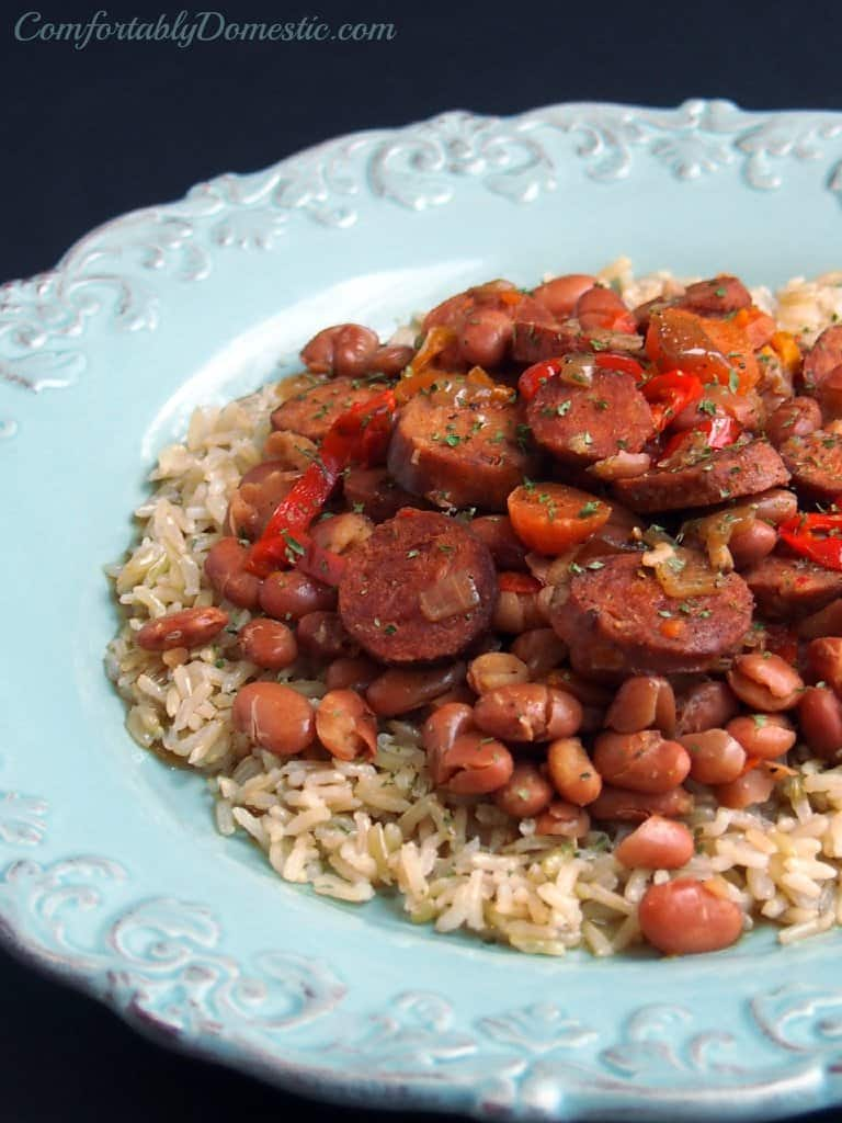 Slow Cooker Andouille Beans and Rice from Comfortably Domestic served in a turquoise bowl over a dark background