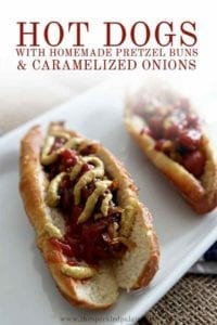 Close up of two hot dogs on homemade pretzel buns, with Pinterest text