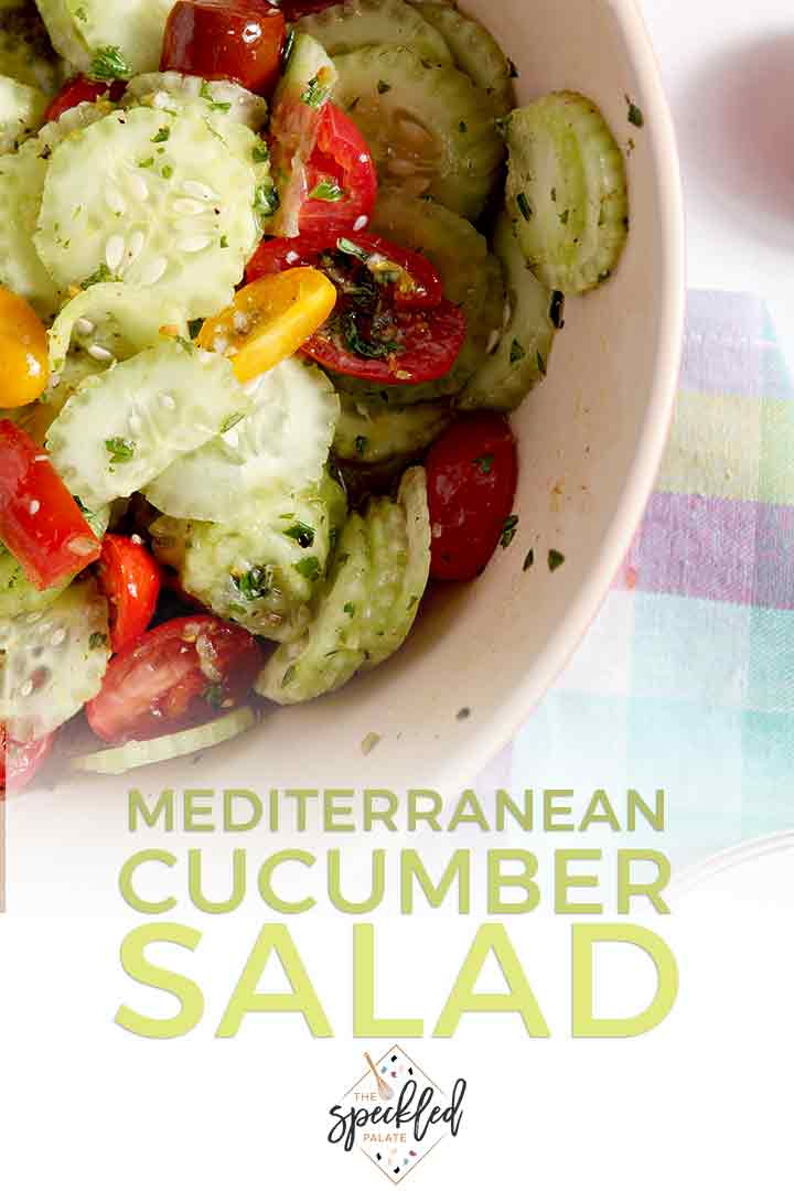 Close up of a bowl holding Mediterranean Cucumber Salad with Heirloom Tomatoes and Lemon Vinaigrette, with Pinterest text