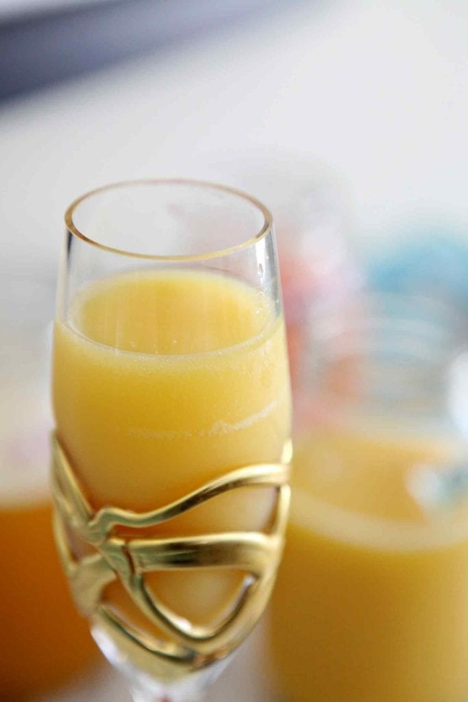 Close up of a peach mimosa (bellini)
