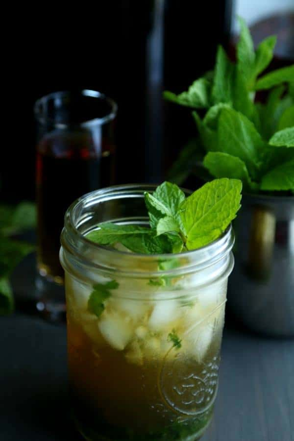 Mint Julep Kombucha Cocktails, served on a dark background, in a mason jar