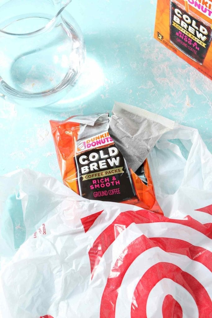 Dunkin' Donuts Cold Brew coffee pack sticking out of a plastic Target bag, ready for brewing