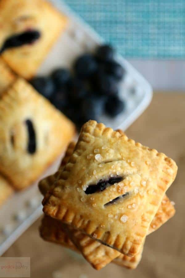 Blueberry Mini Pies are stacked on top of each other before serving