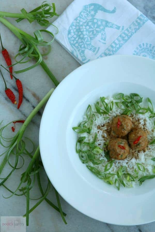Overhead image of Thai Turkey Meatballs, served in a white bowl with Peanut Sauce from Pook's Pantry