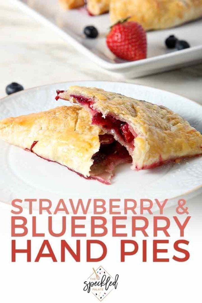 Strawberry and Blueberry Hand Pies make the PERFECT summer dessert. Bursting with fresh blueberries and strawberries, these naturally sweet, handheld pies sing of seasonal flavors. | Blueberry Hand Pies | Fruit Hand Pies | Strawberry Hand Pies | Summer Hand Pies | July 4th Dessert | Memorial Day Dessert | Labor Day Dessert | Patriotic Dessert | Red, White and Blue Dessert | Summer Dessert | #pies #strawberry #blueberry #speckledpalate