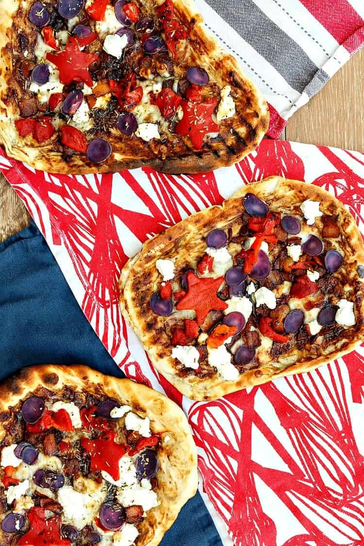 Three Grilled Patriotic Pizzas sit on a red, white and blue background