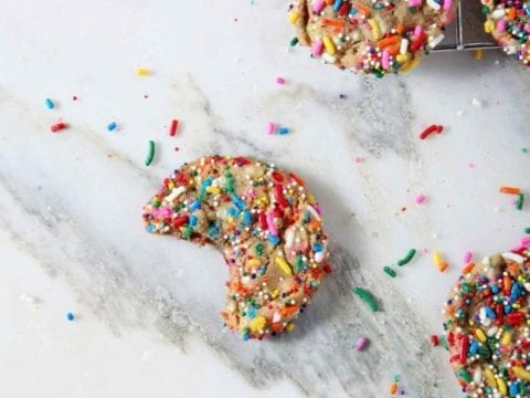 Overhead image of Funfetti Cookies, including one bitten into cookie.