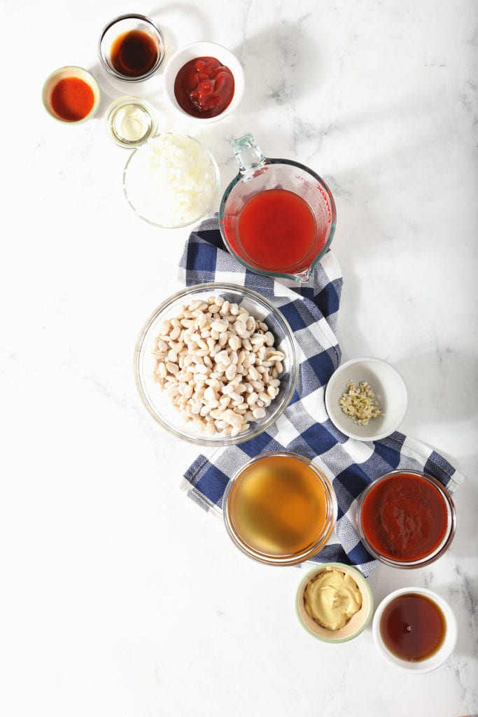White beans with other ingredients in bowls on marble