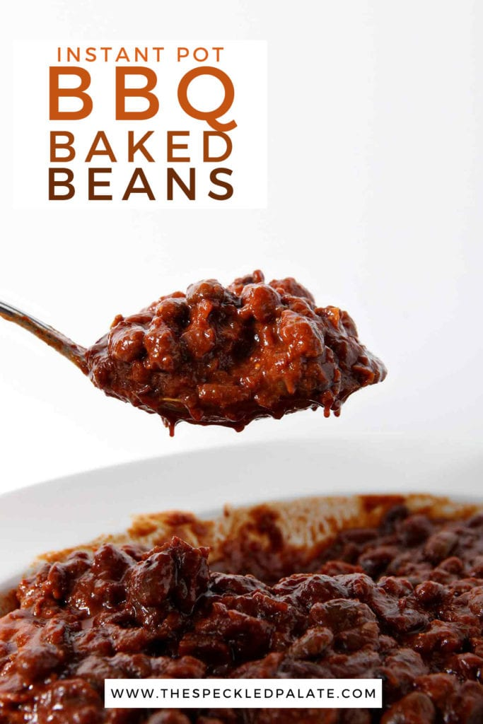 A spoon holds a helping of baked beans with the text instant pot bbq baked beans
