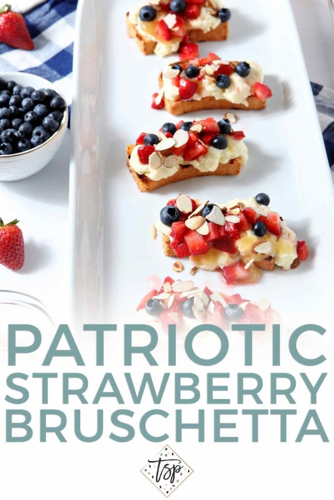 Pinterest graphic for Patriotic Strawberry Bruschetta, showing the final bruschetta on a white platter, surrounded by strawberries and blueberries