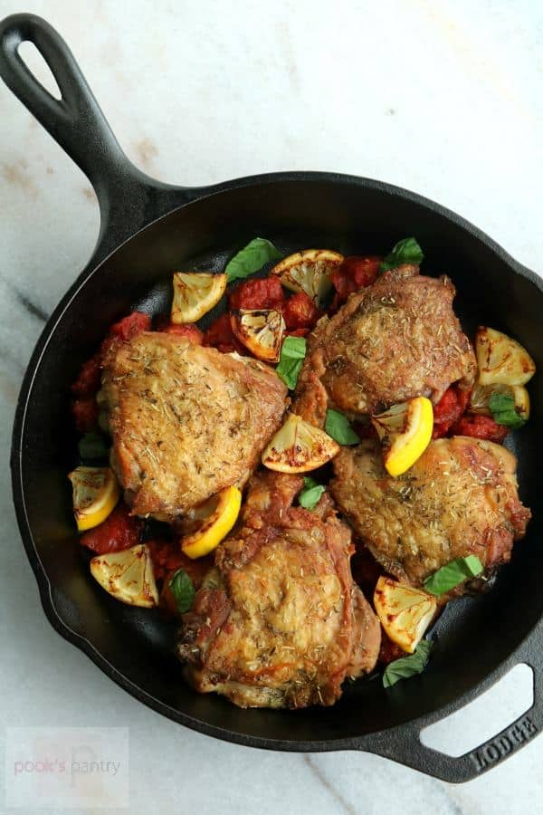 Keto Chicken Thighs with Charred Lemon are served in a skillet