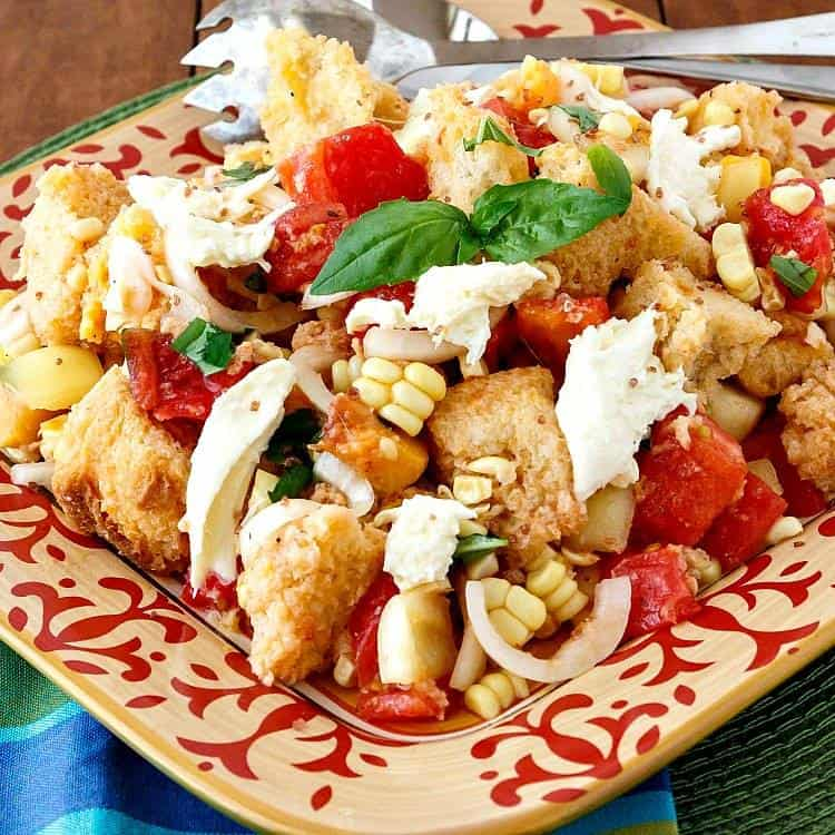 A colorful platter holds a giant serving of Summer Tomato Peach Panzanella.