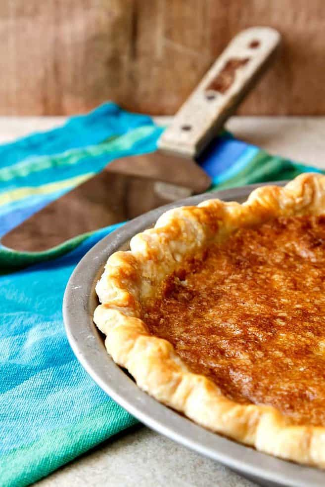 A Vinegar Pie sits on a teal kitchen towel before cutting