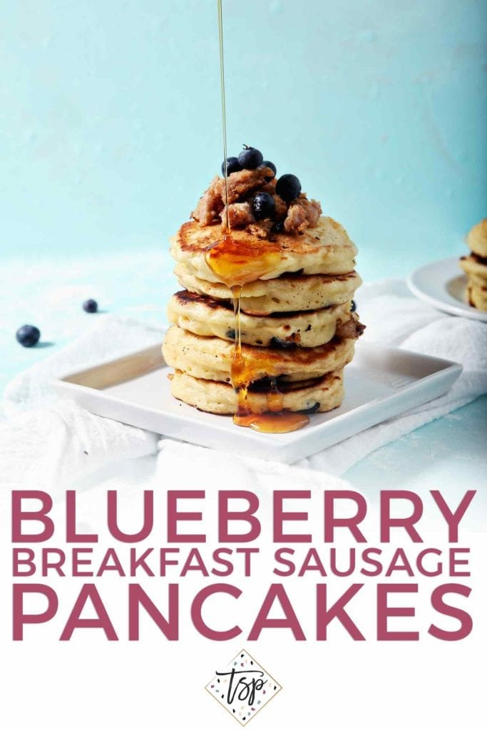 Pinterest graphic for Blueberry Breakfast Sausage Pancakes, featuring a stack of pancakes being topped with maple syrup and text.