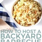"""A bowl of honey mustard coleslaw on a blue checked towel, from above, with the text """"how to host a backyard barbecue"""""""