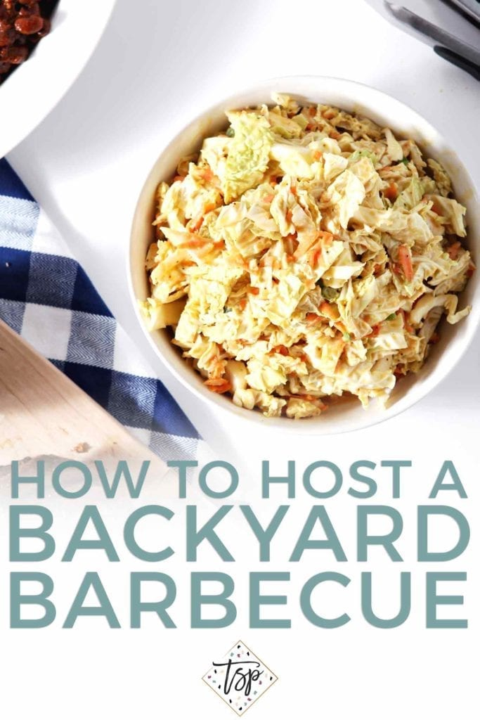"A bowl of honey mustard coleslaw on a blue checked towel, from above, with the text ""how to host a backyard barbecue"""