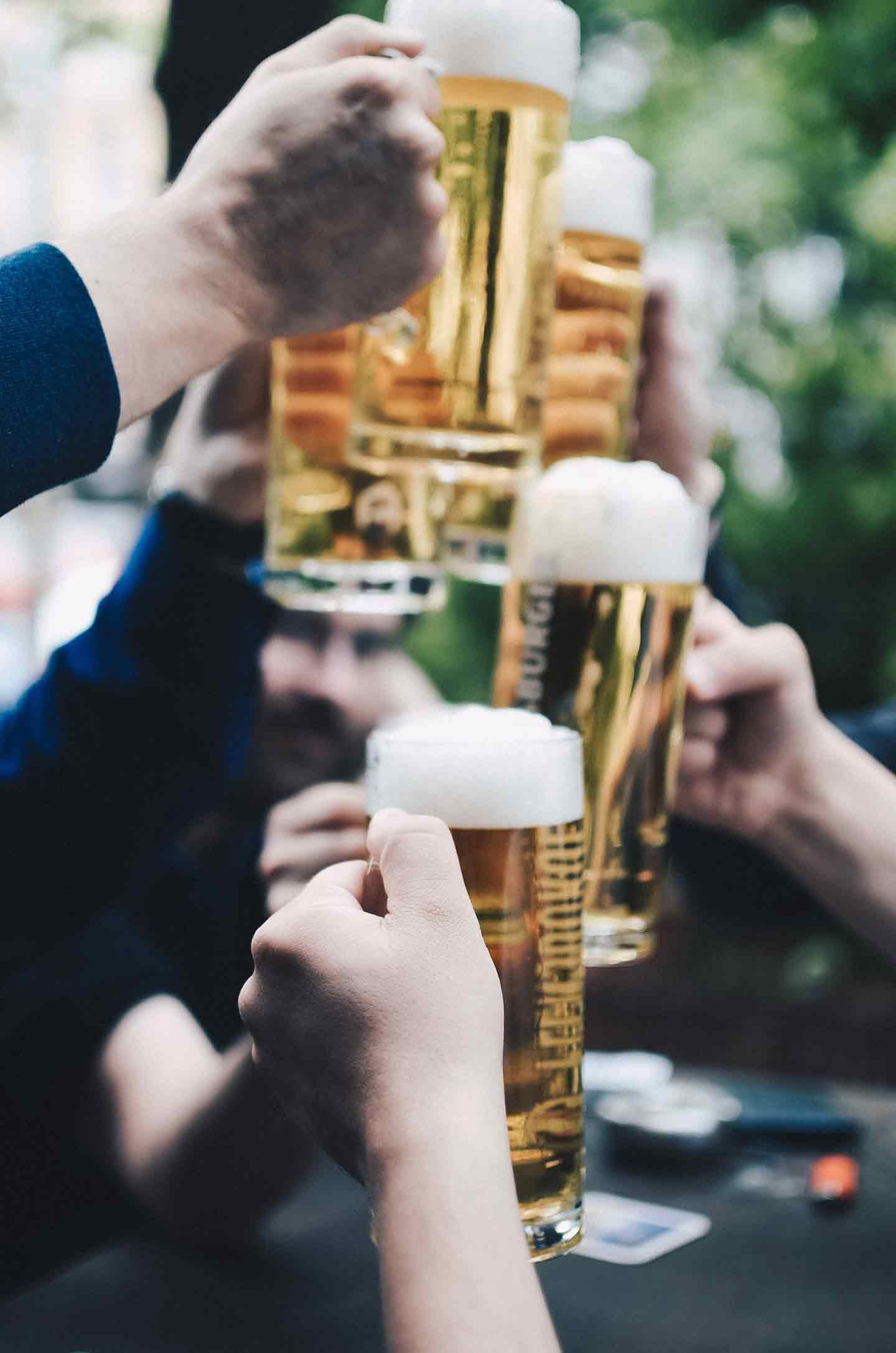 People clink their beer glasses together
