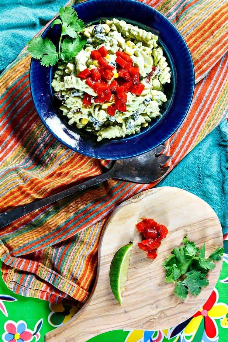 A colorful tables cape features Mexican Pasta Salad with Green Goddess Dressing
