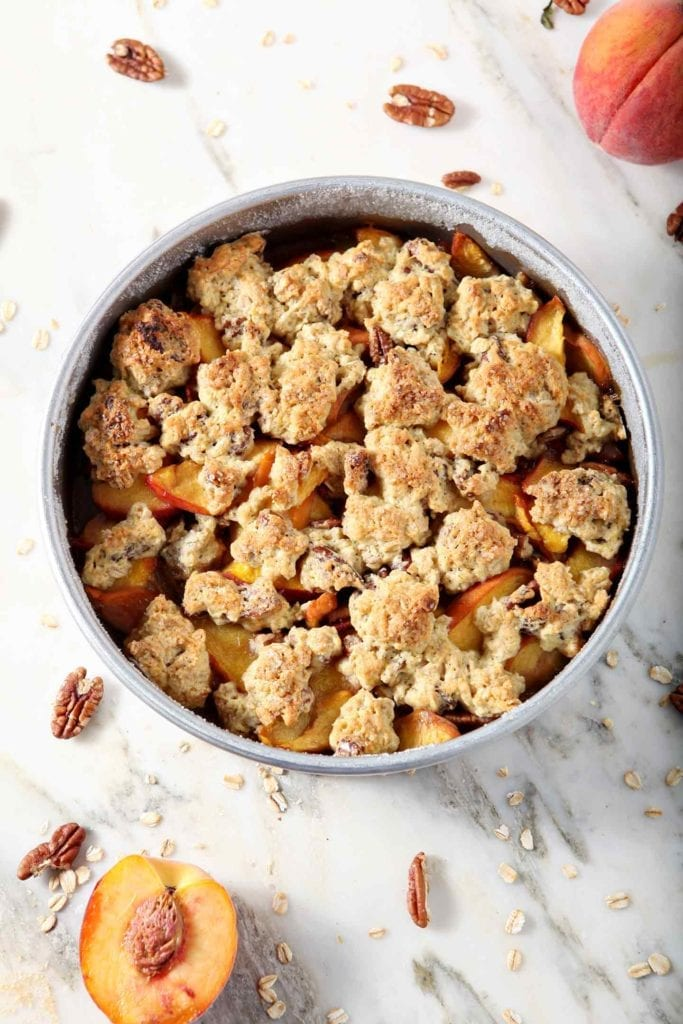 Dairy Free Peach Cobbler is shown from above, straight from the oven