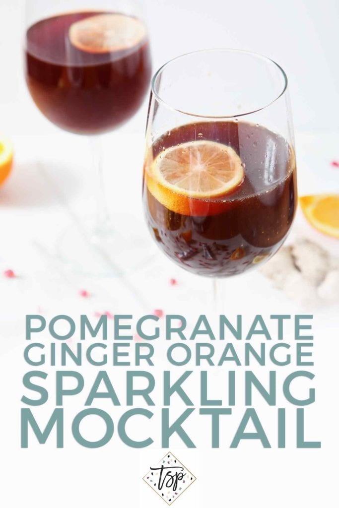Pinterest image for Pomegranate Ginger Orange Sparkling Mocktail, featuring a close up of two of the mocktails and Pinterest text