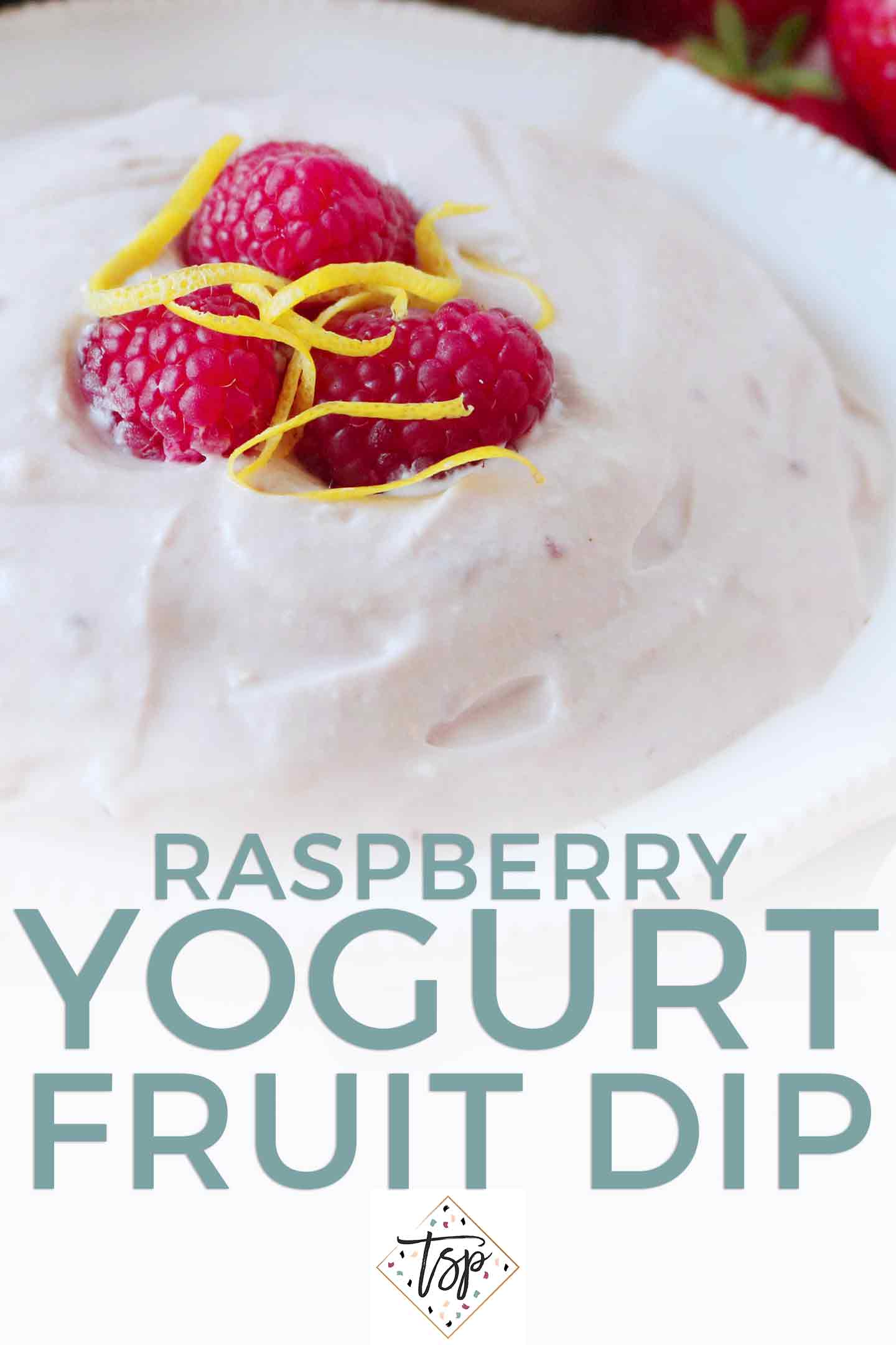 Pinterest image for Raspberry Yogurt Fruit Dip, featuring a close up of the dip, topped with raspberries and lemon zest