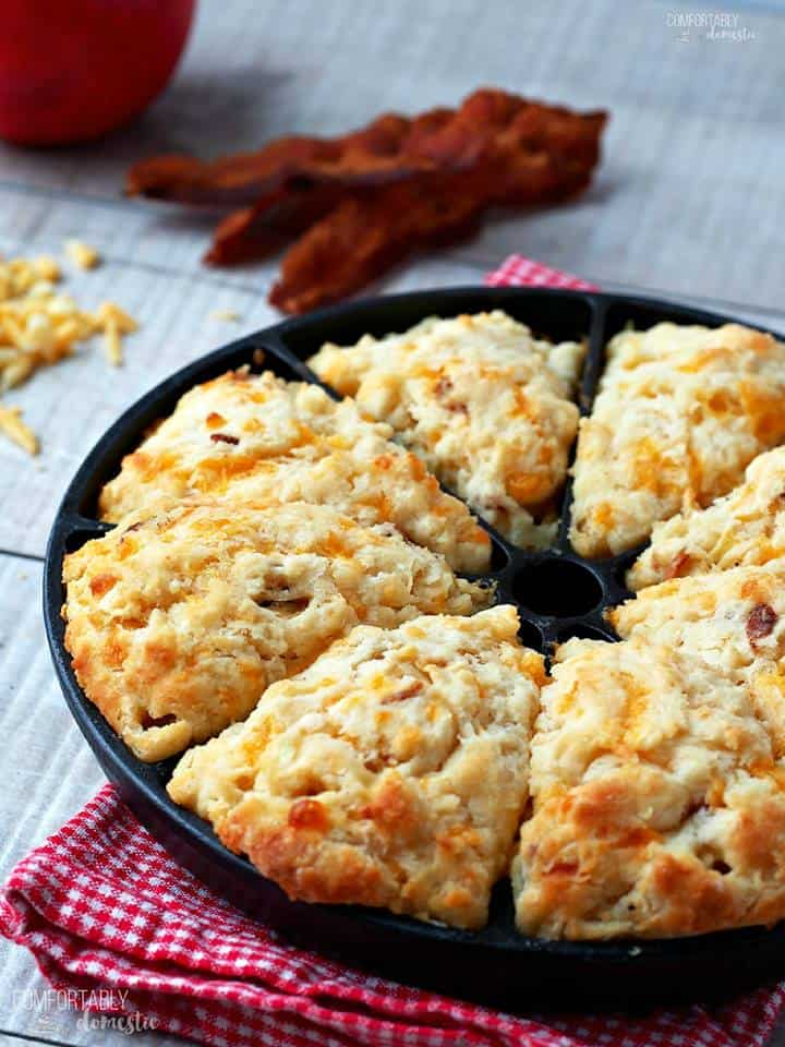 Apple Cheddar Bacon Scones line a pan on a wooden background