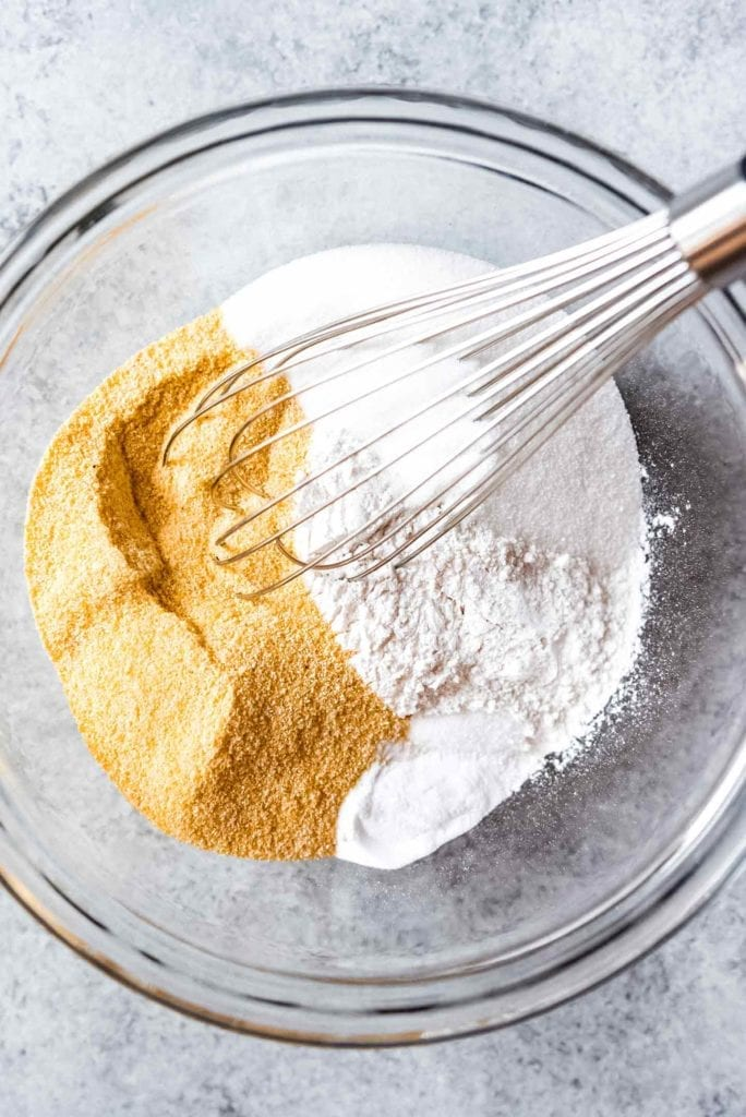 Dry ingredients are shown in a bowl with a whisk