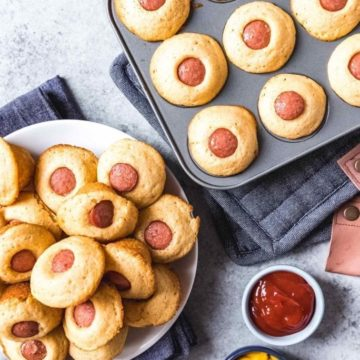 Overhead image of Corn Dog Mini Muffins on a plate and in the mini muffin tin