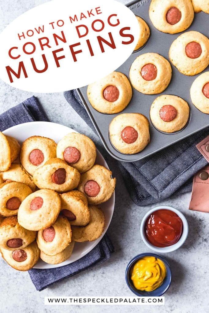 Overhead of a plate of Mini Corn Dog Muffins and a muffin tin holding more next to bowls of ketchup and mustard with the text 'how to make corn dog muffins'