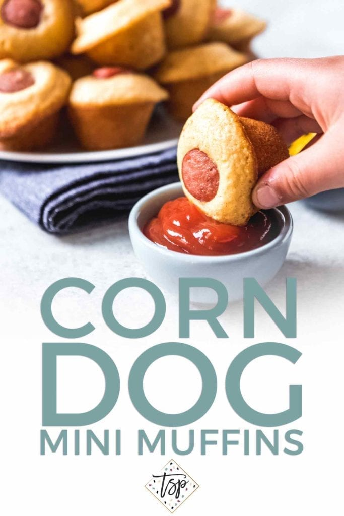 Pinterest photo for Corn Dog Mini Muffins, featuring text and a person dipping a mini muffin into a bowl of ketchup