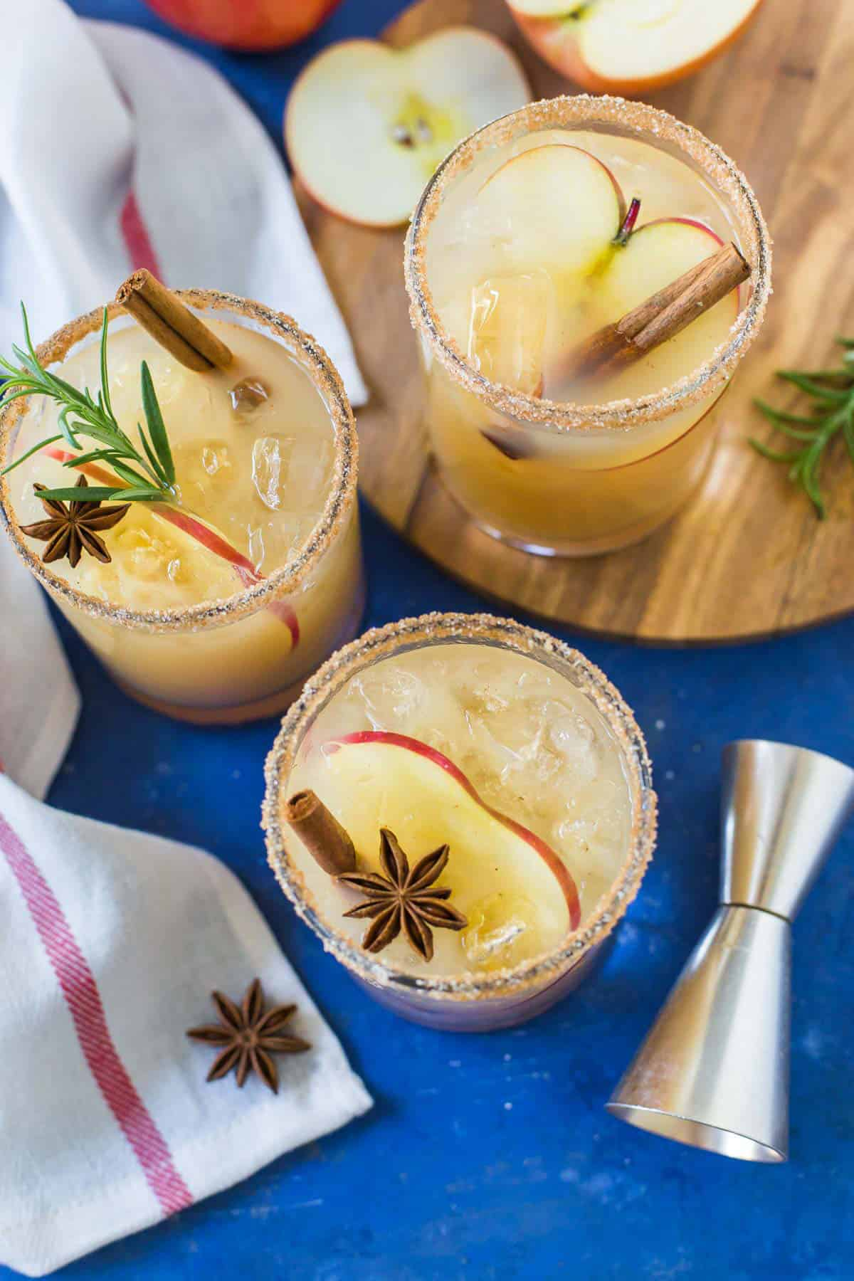 Overhead image of Apple Cider Margaritas on a blue background