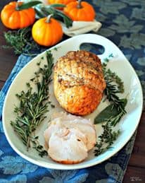A white platter holds a Citrus Herb Roasted Turkey
