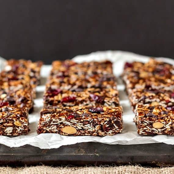 A white plate is lined with several Vegan No Bake Chocolate Chip Granola Bars