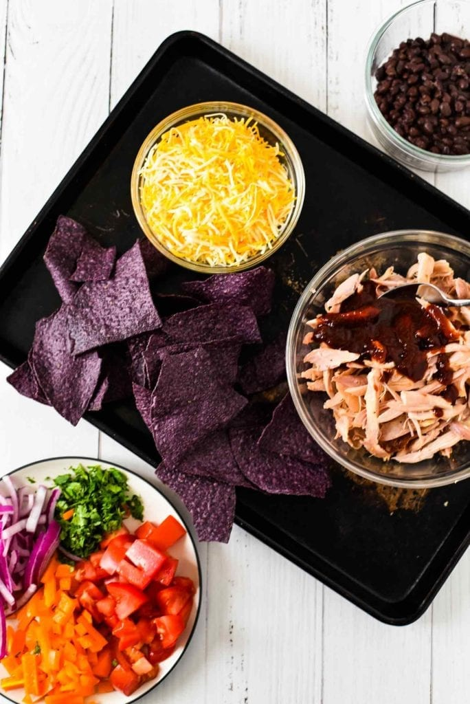 Ingredients for Sheet Pan BBQ Chicken Nachos shown from above