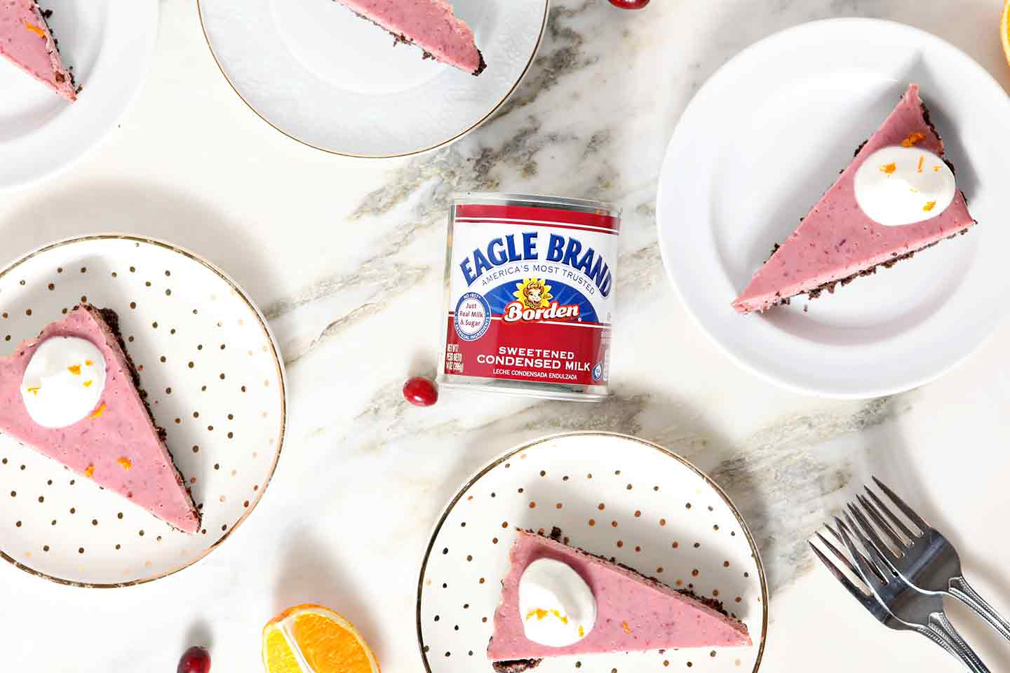 Slices of Creamy Cranberry Tart surround a can of Eagle Brand Sweetened Condensed Milk