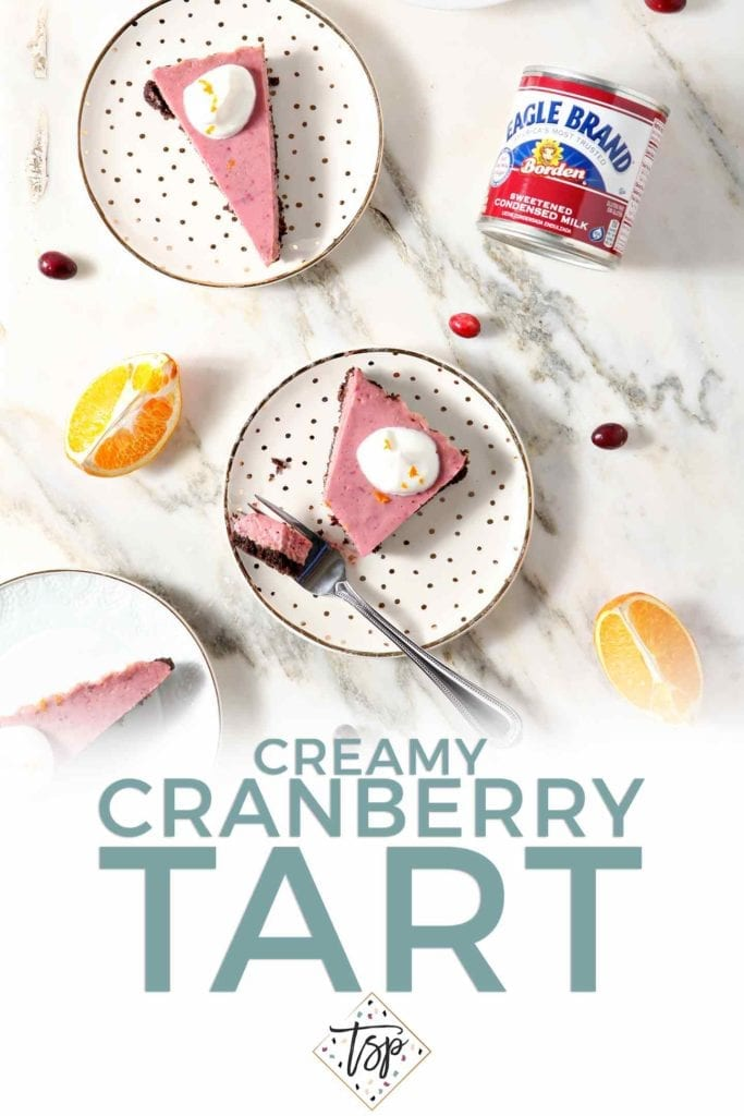Pinterest image for Creamy Cranberry Tart, featuring text and several slices of the tart with fresh whipped cream