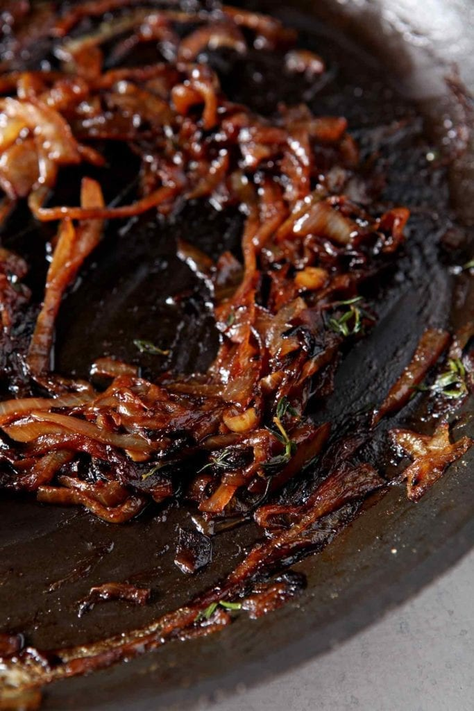 Caramelized onions are shown in a pan before going into the refrigerator to cool for French Onion Biscuits