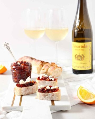Orange Cranberry Compote is served on toasted bread to create a sweet-savory Thanksgiving bruschetta and is served with Vinho Verde wines