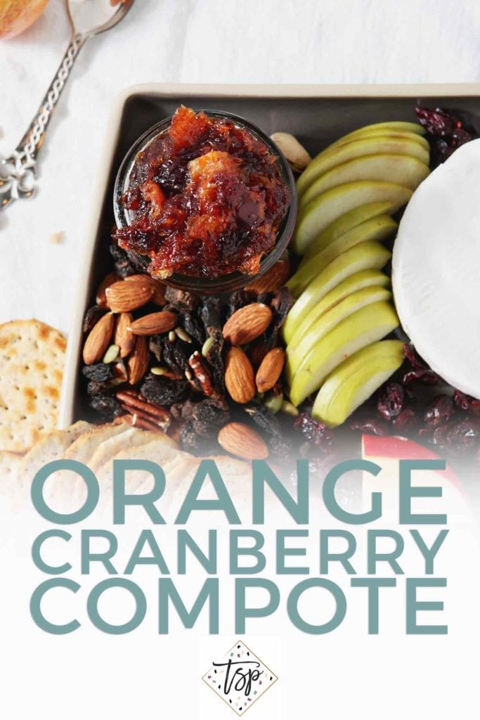 Pinterest image of Orange Cranberry Compote, shown from above on a cheese board with Pinterest text