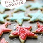 Close up of star-shaped tea cake cookies, with Pinterest text