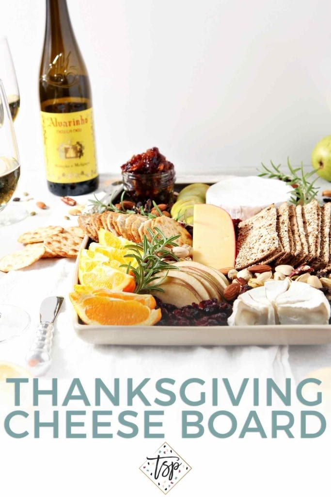 Pinterest image of Thanksgiving Cheese Board, featuring the cheeseboard, served with Vinho Verde wine, the cheese board and Pinterest text