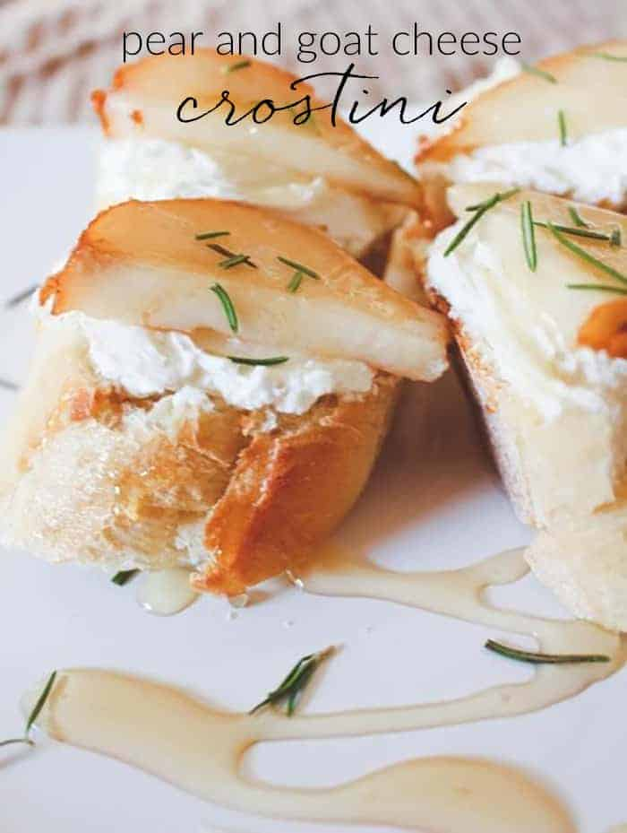 A close up of Pear and Goat Cheese Crostini on a white plate