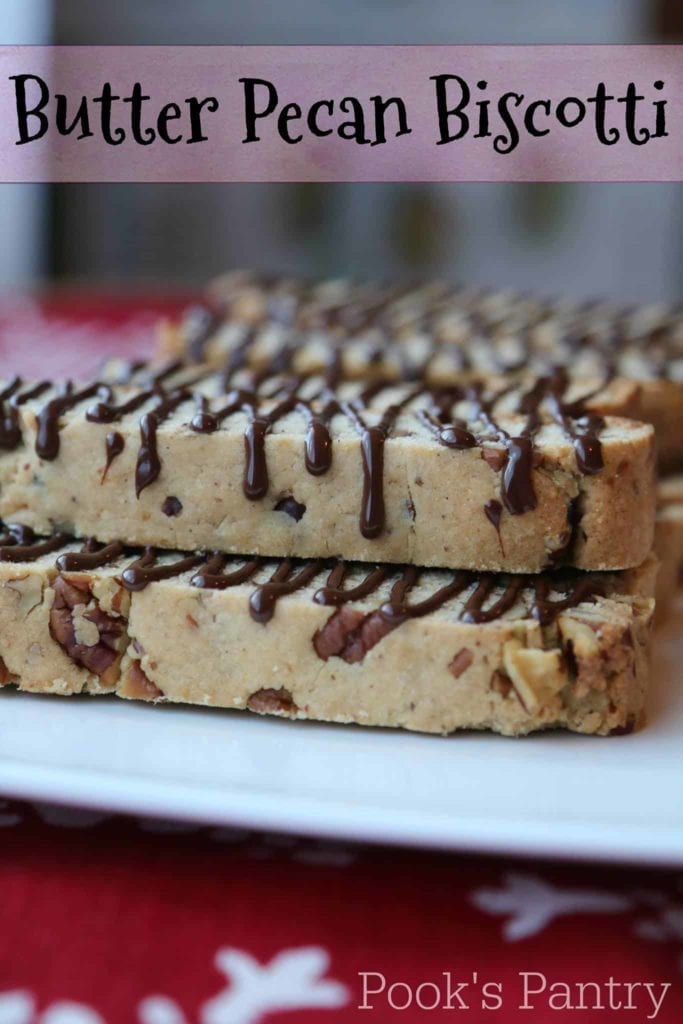 Butter Pecan Biscotti is stacked on top of a white plate